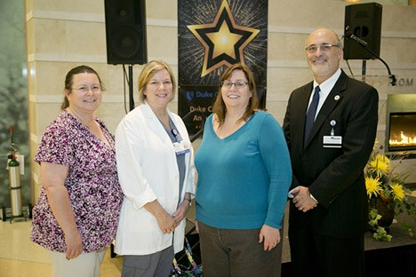 Photographed from left to right: Leann Richards, Martha Lassiter, Cheryl Morgan Maxey, and DCI executive director Michael Kastan, MD, PhD.