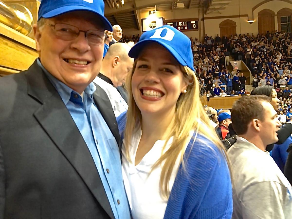 Duke Cancer Institute hematologic malignancies specialist Joseph Moore, MD, and his daughter Andrea Edith Moore, pose while at a basketball game against the University of North Carolina. Andrea Edith Moore, a critically acclaimed soprano, will perform with the Chamber Orchestra of the Triangle on Sunday, March 22, at the Carolina Theatre, which located in Durham. Complimentary tickets are available to Duke faculty and staff. To have your name added to the guest list, call 919.684.3752.