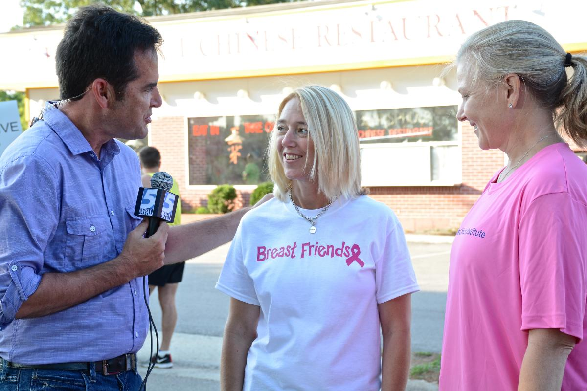 Bryan Mims, WRAL, speaks with Tamara Nuckols and Kimberly Blackwell at the start of Saturday's Komen Race For The Cure. Nuckols, 45, was referred to Duke when her HER2-positive breast cancer metastasized to her brain. Nuckols headed up Team Breast Friends.