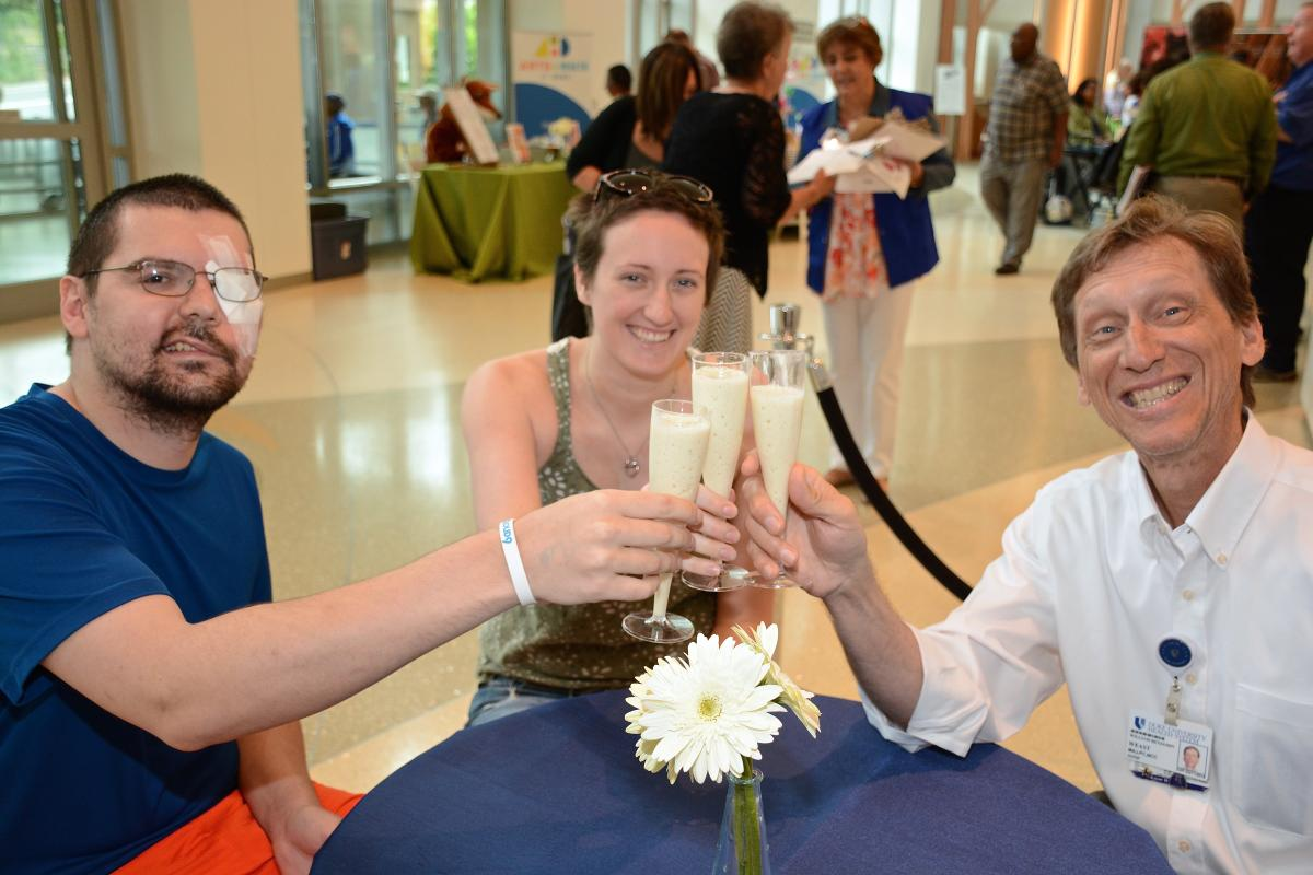 Alex Giffen, girlfriend Kelsey Reilly and medical family therapist Ben Weast, LPC, toast the day with a freshly made banana smoothie. Giffen was diagnosed in February with adenoid cystic carcinoma.