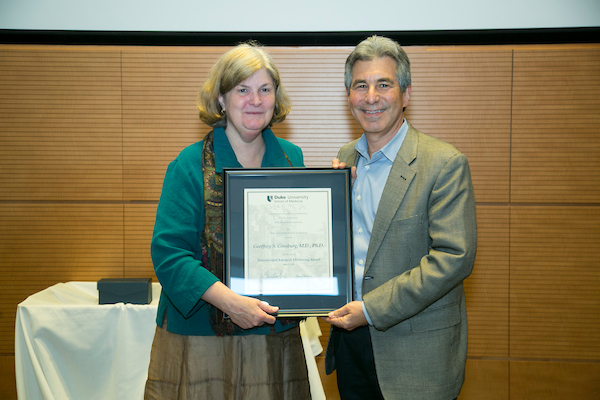 Nancy C. Andrews, MD, PhD, Dean of the School of Medicine and Vice Chancellor for Academic Affairs, presents Geoffrey Ginsberg, MD, PhD, with aResearch Mentoring Award for Translational Research.