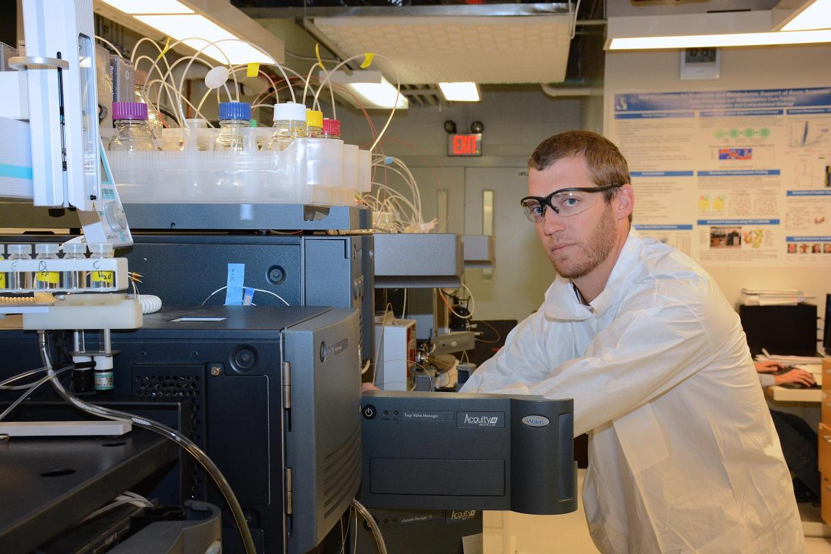 Erik Soderblom, Ph.D., laboratory analyst II, works with a recently acquired Waters HDX-MS system, an emerging technology in DPMCF used to map drug binding sites on the surface of proteins or protein complexes.
