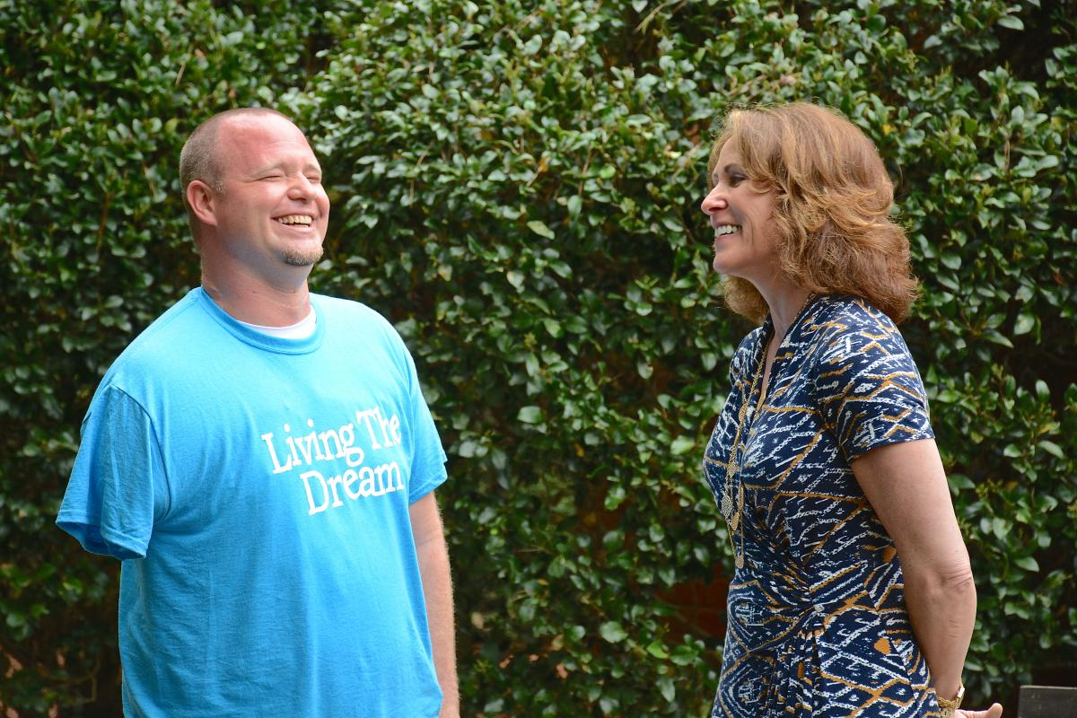 Always upbeat, Brandon Lail, who in May 2014 lost his right arm to chondrosarcoma, shares a laugh with Kelly Mulhern, operations manager at Caring House. Caring House is a local non-profit organization providing supportive and affordable housing for adult patients receiving treatment at Duke Cancer Institute. Lail is a regular at Caring House, visiting every three months when he comes to Duke for check-ups.
