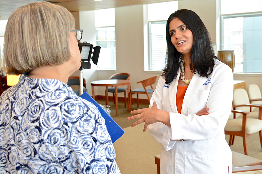Duke breast cancer researcher Gayathri Devi, PhD, speaks with a reporter in 2015 about the aggressive nature of inflammatory breast cancer.