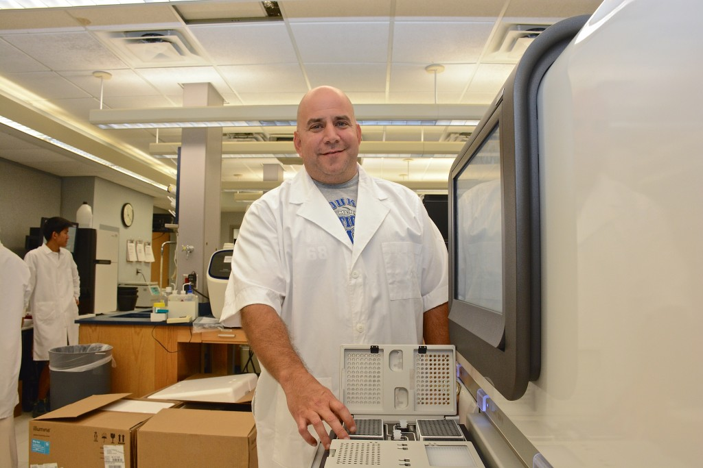 Graham Alexander, research analyst, prepares to utilize the PacBio RS II.