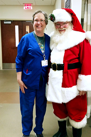 A heavier Paula Hocutt poses with Santa Claus. She has since lost more than 30 pounds.