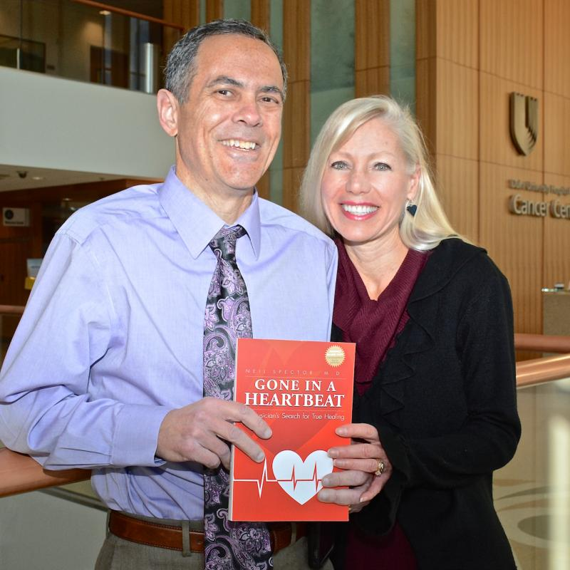 Neil and Denise Spector with his book