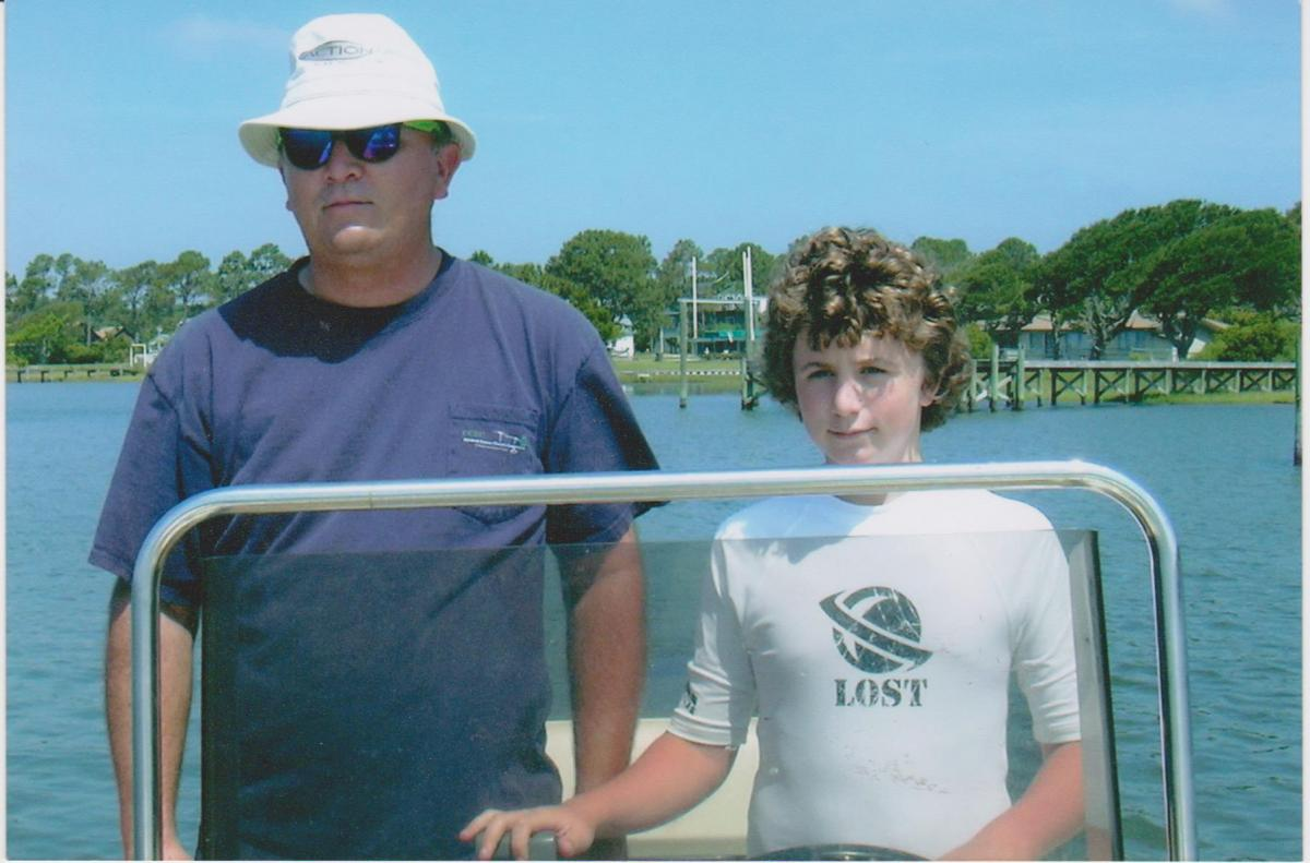 This is the Baysden's favorite photo of Ken on the boat he's had for 24 years. Taken around 2003, he's teaching their son Carl to drive the boat and maneuver around sand bars.