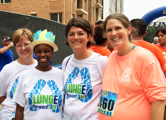 Nine months pregnant with her third child, Kristen Walden (right), an infusion nurse at Duke Cancer Center Raleigh, poses with members of her Duke Cancer Center Raleigh team, the Duke Raleigh Lung Rangers.