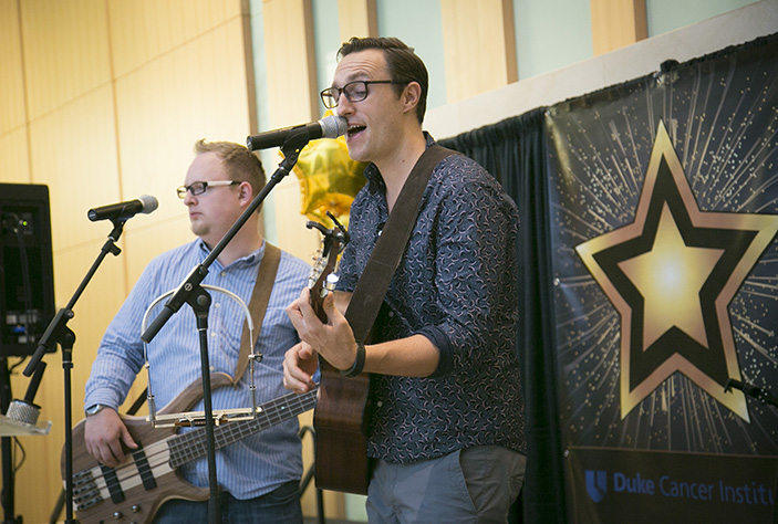 Daniel Nickels, RN, performs an original song from his new album, The Answer.