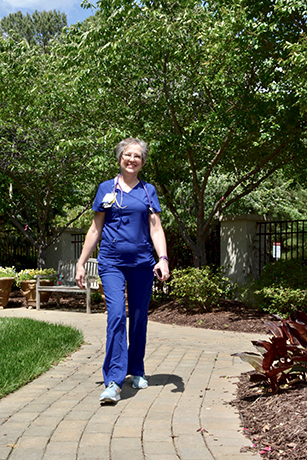 Taking a break, Paula Hocutt gets some steps toward her 10,000 while taking a walk in the garden next to Duke Cancer Center Raleigh. Adopting a healthy lifestyle, Hocutt has lost more than 30 pounds.