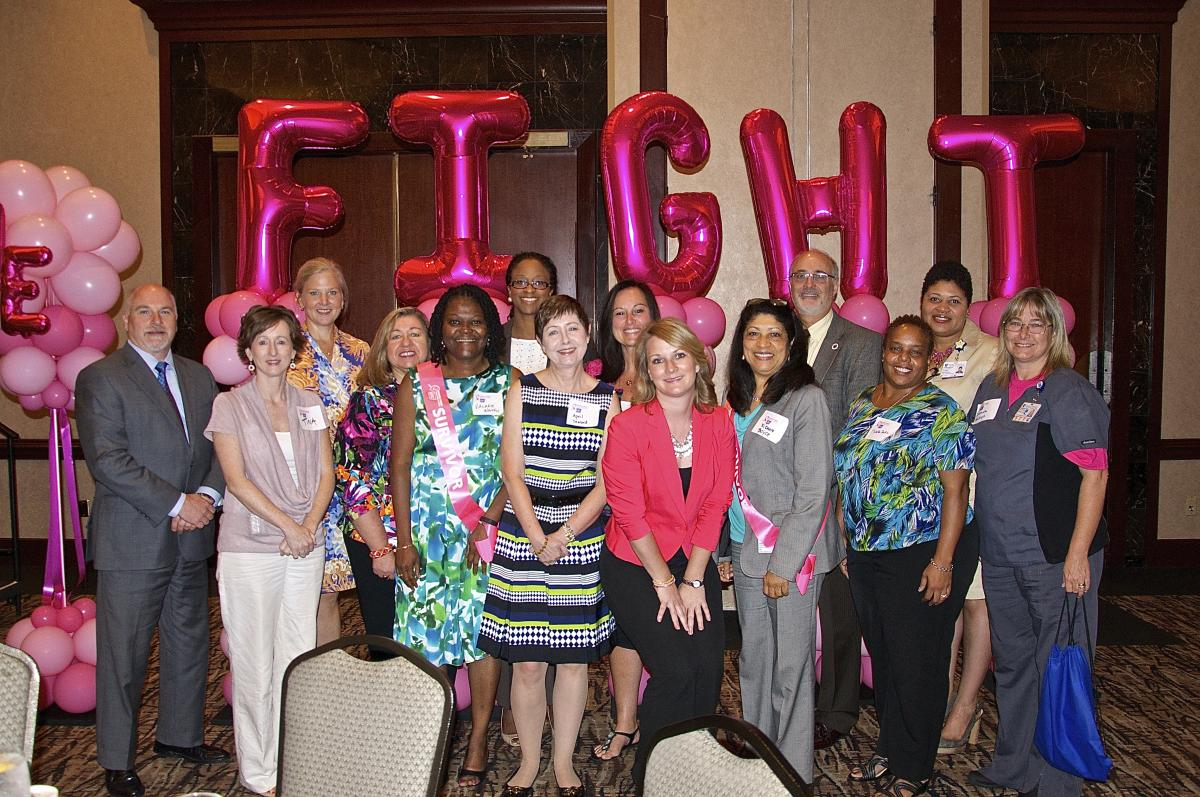 DCI guests attending the 2014 Making Strides Against Breast Cancer pose in front of a Finish The Fight balloon display. The DCI has been named this year's local presenting sponsor. Kimberly Blackwell, M.D., served as a keynote speaker at the Aug. 7 breakfast, held at the Sheraton Imperial Hotel in Durham.