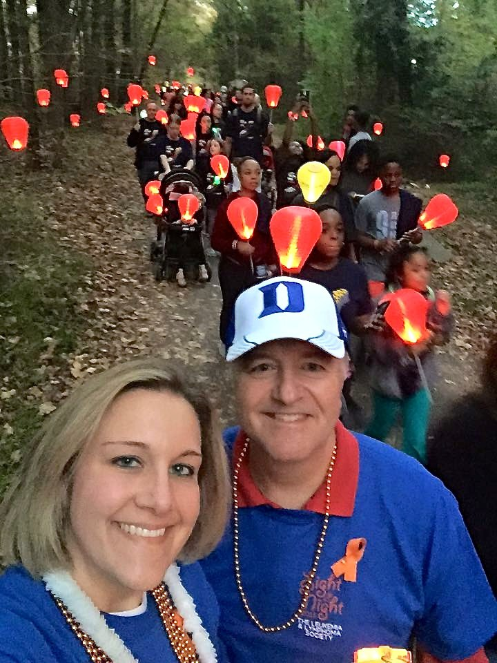 Nicole Kenney, BSN, RN, CN III, poses with her father at a previous Light The Night Walk in Raleigh.