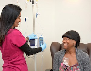 Hital Patel, RN, BSN adjusts Laura Elzie's chemotherapy infusion.