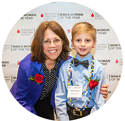 Man and Woman of the Year candidates compete for the title by raising funds in honor of two local pediatric survivors, a boy and a girl. Boy of the Year Benjamin Byers, photographed here with Woman of the Year candidate Stefanie Sarantopoulous, MD, PhD, was treated at Duke for lymphoblastic leukemia.