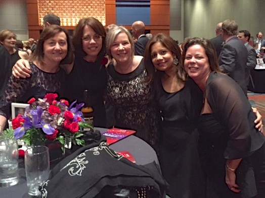 At the LLS Gala, supporters from team Life Sabers gather around Woman of the Year Stefanie Sarantopoulos. Pictured left to right: Tanya Helms, ABMT NP; Woman of the Year Stefanie Sarantopoulos, MD; Martha Lassiter, ABMT nurse clinician; last year's Woman of the Year Arati Rao, MD; and Jennifer Frith, ABMT clinic nurse manager.