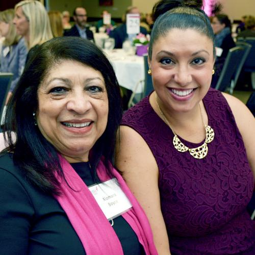 "DCI patient navigator Xiomara Boyce (left) celebrates her ""Spirit to Impact"" award with her daughter Xylina."